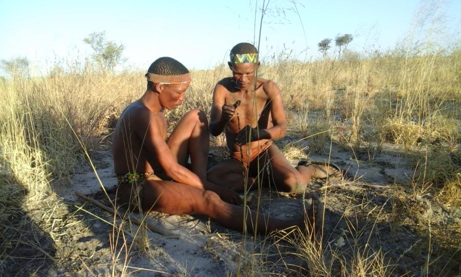 San People (Bushmen) making a fire.  Kalahari Desert, Eastern Namibia