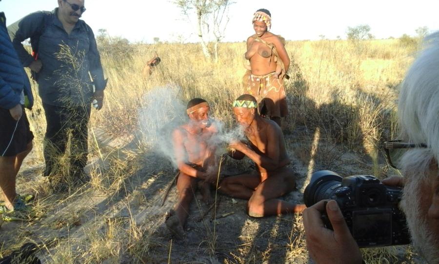 Tourists &  some San People (Bushmen) in the bush.  Kalahari Desert, Eastern Namibi