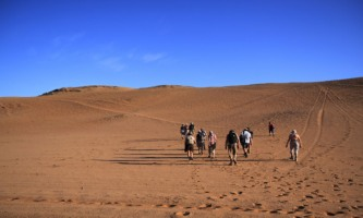 Group of French Tourists hiking in Homeb Desert, Namibia